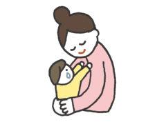 男の子を抱きしめる母親