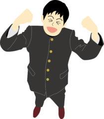 ガッツポーズをする中学生男子